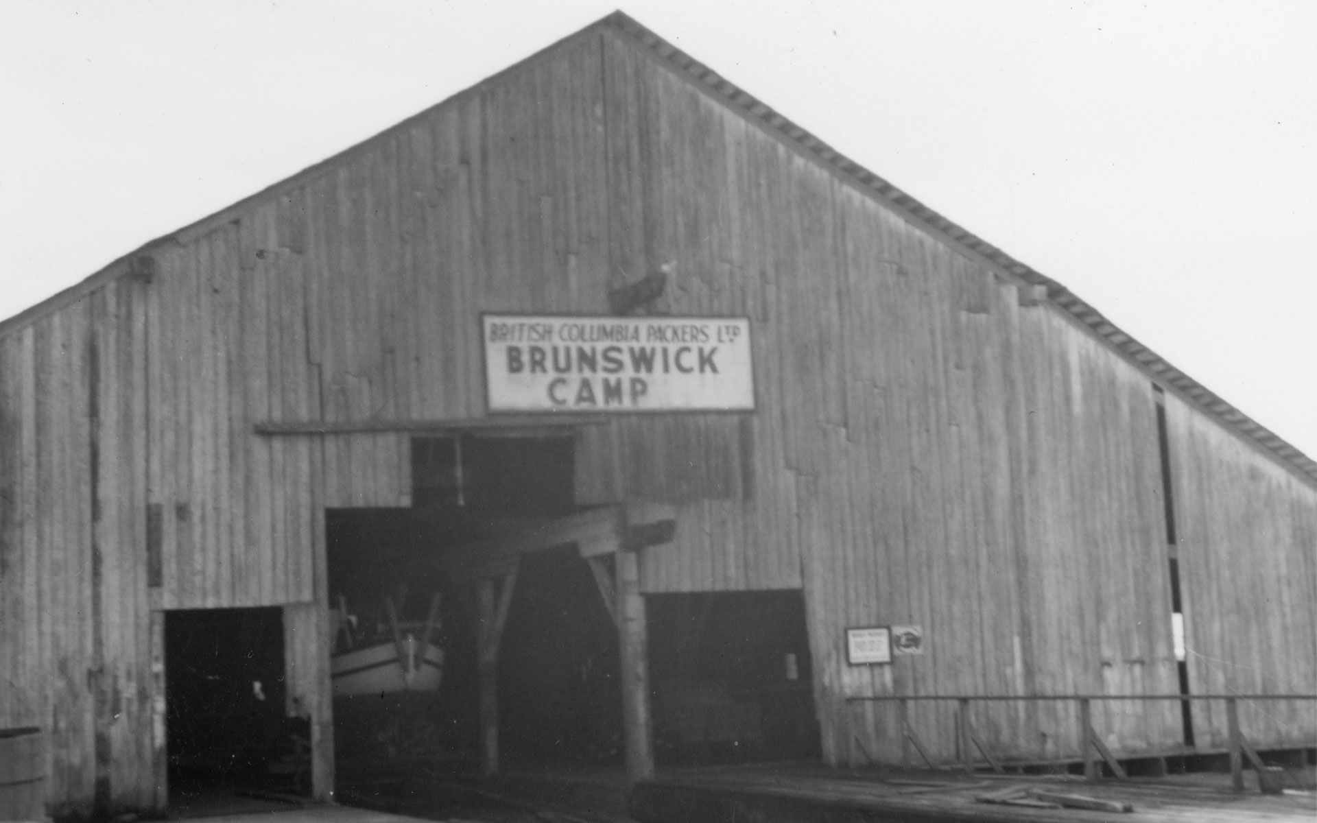"Brunswick Camp dry dock, with a sign reading ""British Columbia Packers Ltd. Brunswick Camp"""