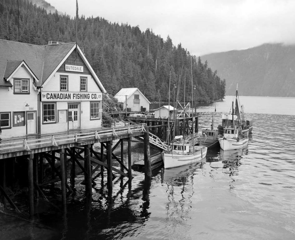 "Wharf at the Butedale cannery village. Signs on the main building read ""Butedale"" and "" The Canadian Fishing Co. Ltd."""