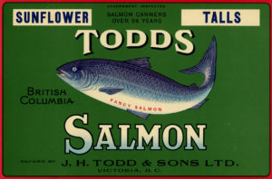 Étiquette verte montrant un saumon et l'inscription « Sunflower Talls. Todds British Columbia Salmon packed by J.H. Todd and Sons Ltd. Victoria B.C. ».