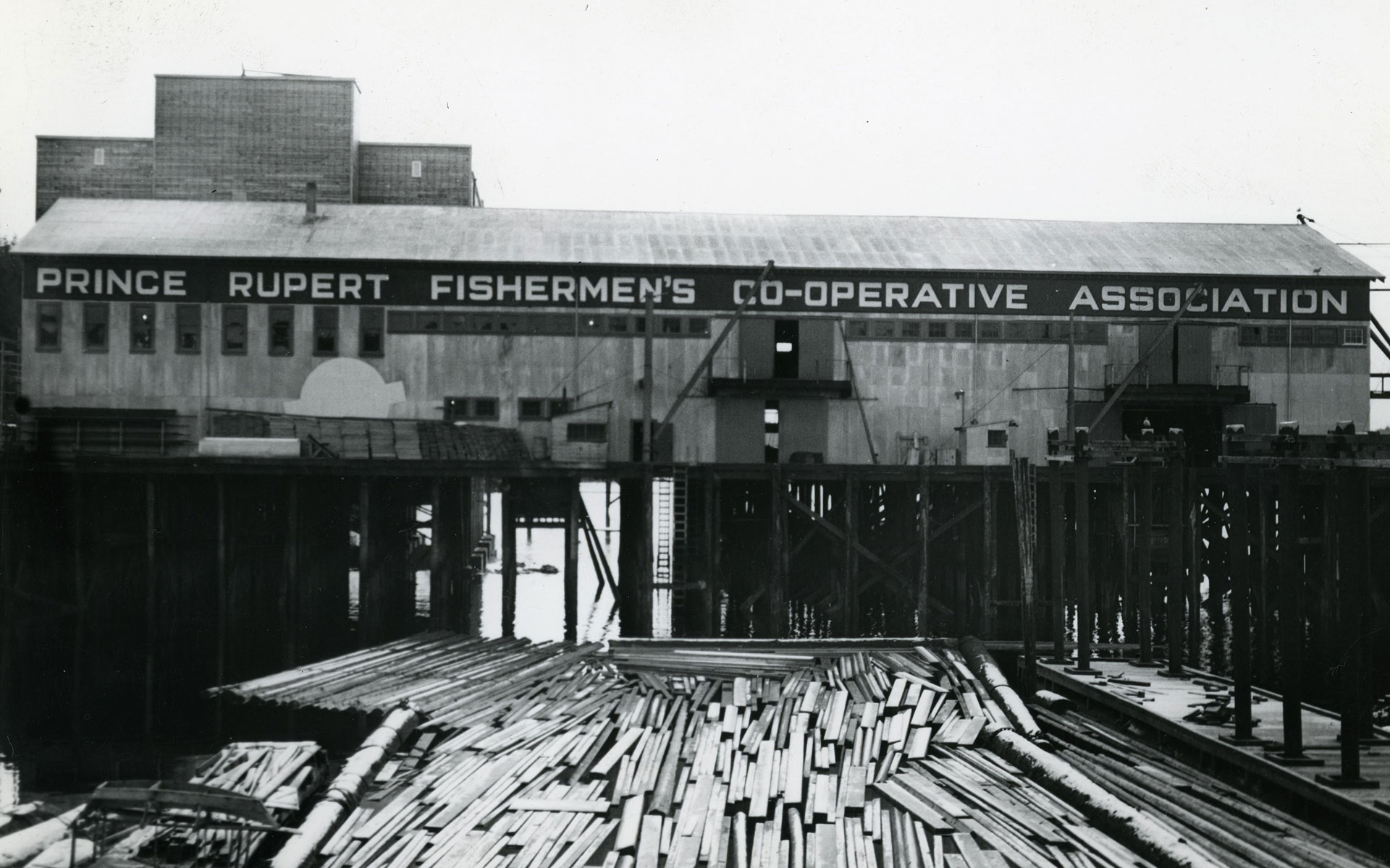 Exterior view of fish shed on pilings.