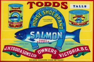 Can label features a salmon in an upside down horseshoe.