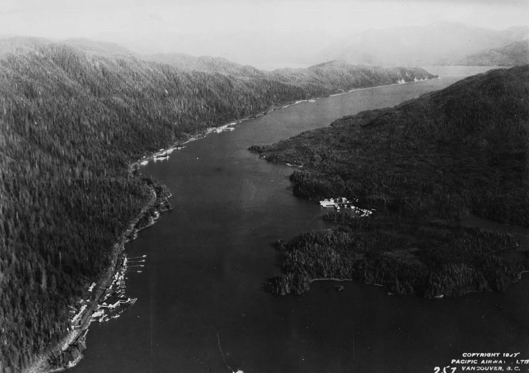 "Rivers Inlet and surrounding land. Text in the bottom right side of the image reads ""Copyright 1927 Pacific Airways Ltd. Vancouver B.C."""