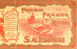 Label features two fishermen in a skiff with a salmon in their net.