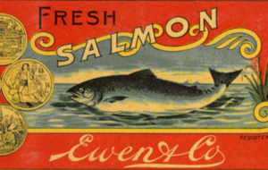 Red label features imagery of swimming salmon, coins, and a lion.