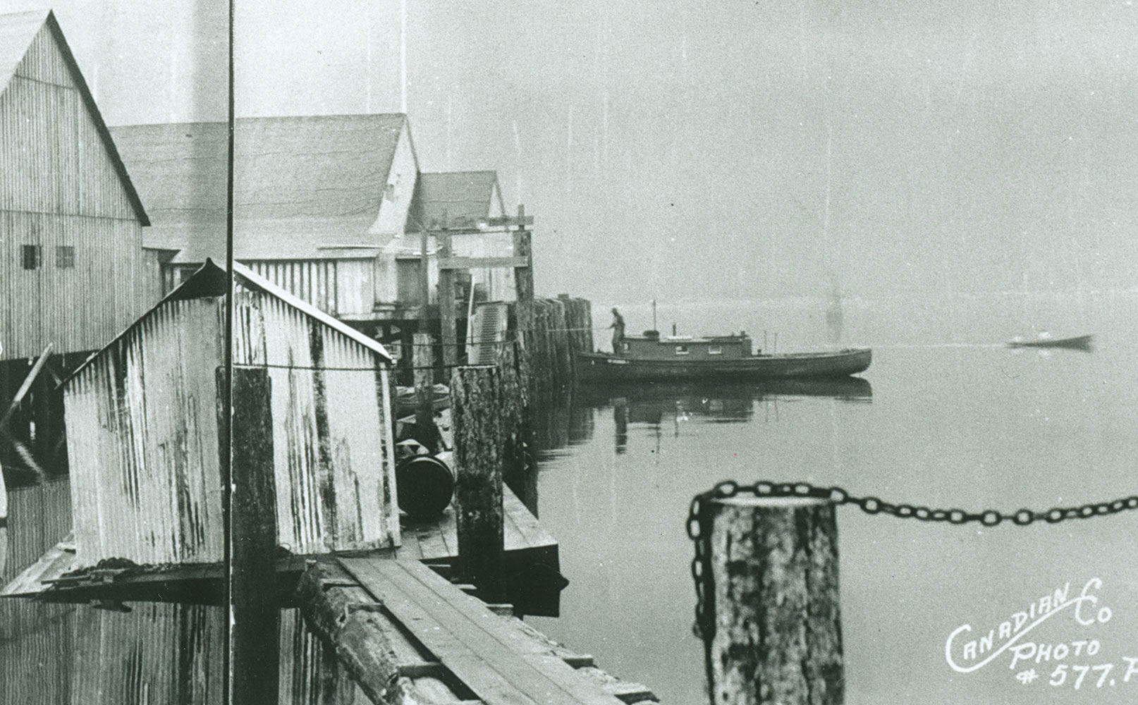 "The main cannery building is supported by floats and pilings. The words ""Canadian Co. Photo #577.P."" are inscribed on the photo."